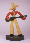 Click to view Mexican w/ Guitar Door Stop photos